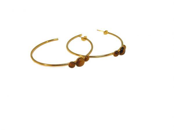 Créoles dorées à l'or fin et ornées de cabochons oeil de tigre.