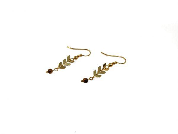 Boucles d'oreilles Paloma dorées à l'or fin avec ses perles en oeil de tigre.