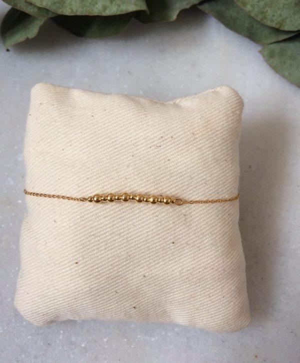 Bracelet chaîne fine et perles métal dorés à l'or fin
